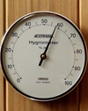 4355: Silver rimmed glass encased hygrometer