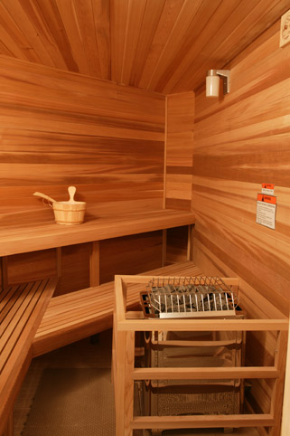 FPC CUSTOM CUT ANGLED SAUNA ROOM OF WESTERN RED CEDAR WITH FLOOR MODEL HEATER